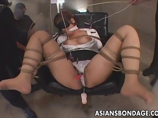 Japanese babe in bondage action