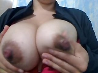 Huge milk laden tits lactate on cam