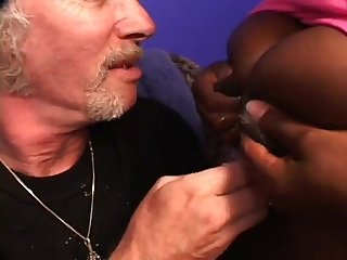 Lactating ebony feeds grandpa