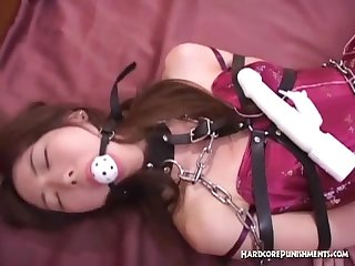 Sexy oriental babe ball gagged and wrapped in chains