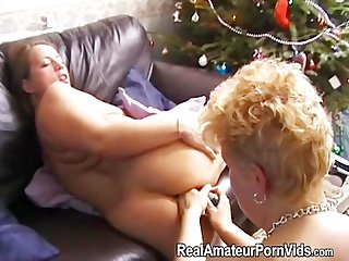 An older houswife toys a plump housewife and fingers her ass