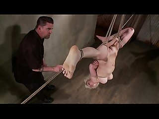 Blond suspended upside down by master for his pleasure