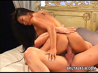 Asian whore tames the thick dick in royal bed