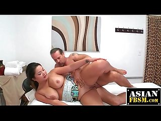 Curvy asian masseuse rides cowgirl