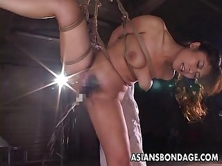 Kinky Asian babe in bondage receives a nasty dildo