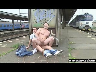 Two horny hunks fucking outdoor at a train station