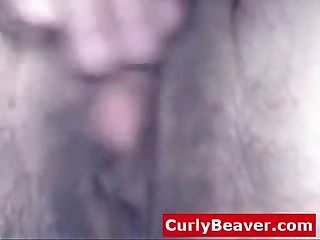 Amateur girl with hairy pussy and huge clit masturbates