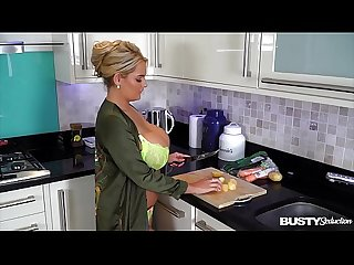 Busty seduction Katie T. fills her shaved pussy with veggies in the kitchen