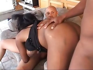 Busty honey skin slut gets double penetrated and jizzed in the living room