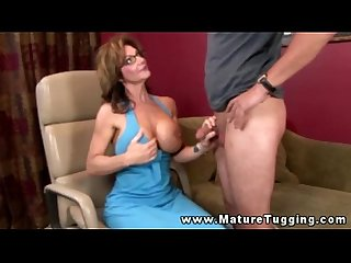 Mature busty handjob milf tugging on cock
