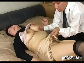 Nice-looking asian older plays with water on her juicy pussy