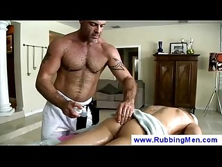 Masseur sticks dildo in guys asshole